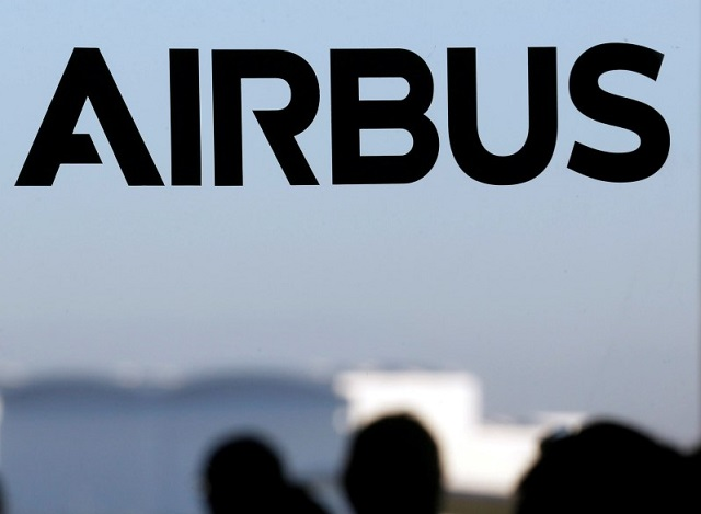 People speak together near a logo of Airbus Group during the Airbus annual news conference in Colomiers, near Toulouse, January 13, 2015.     REUTERS/Regis Duvignau/File Picture