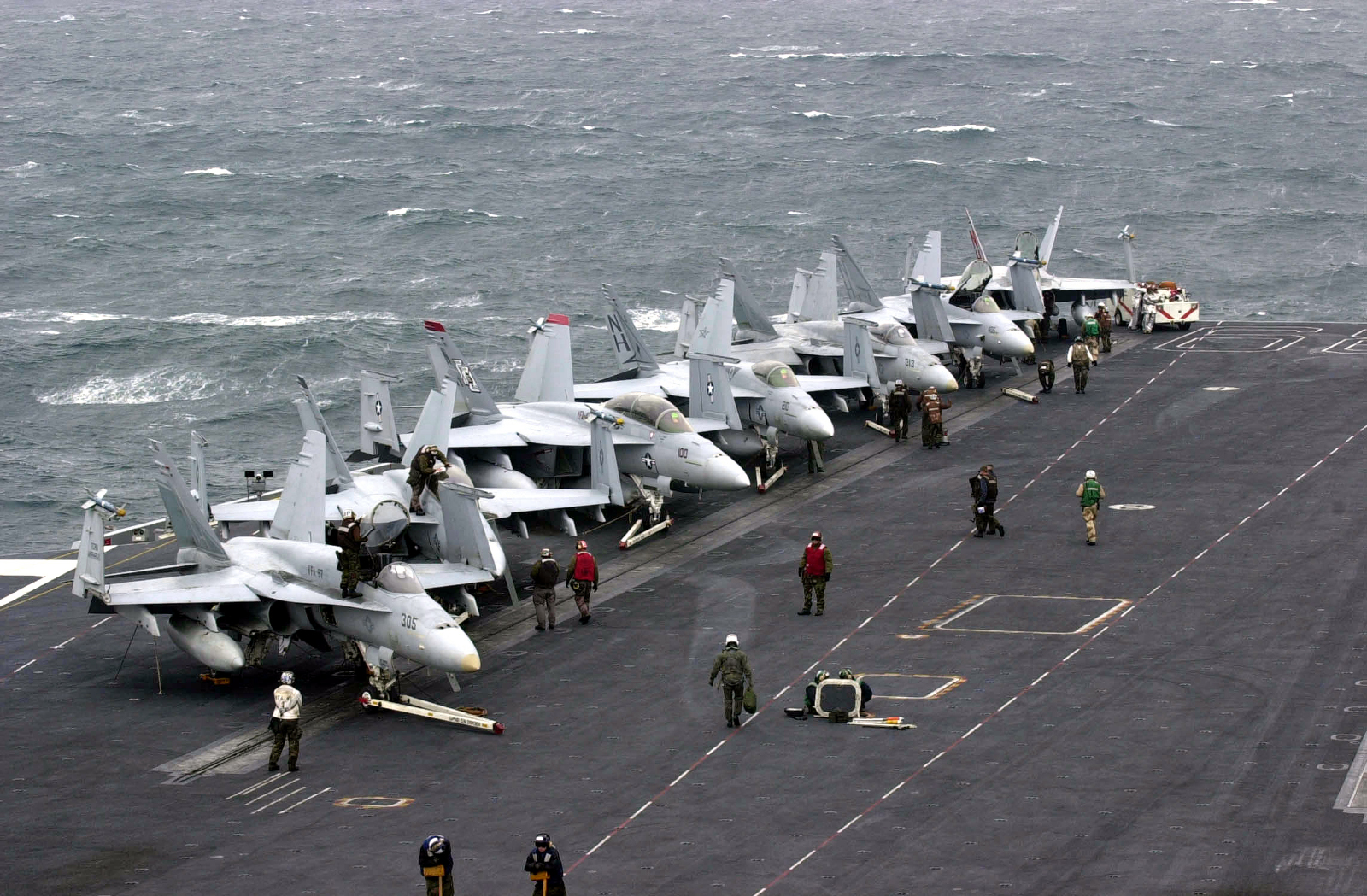 020924-N-2385R-003 At sea aboard USS Nimitz (CVN 68) Sep. 24, 2002 -- F/A-18 ÒHornetsÓ and ÒSuper HornetsÓ stand ready on the shipÕs flight deck awaiting their next combat mission.  Nimitz is currently conducting Tailored Ships Training Availability (TSTA) Two and Three off the coast of California, designed to help integrate the ship and embarked air wing while preparing for future deployments.  U.S. Navy photo by PhotographerÕs Mate 3rd Class Yesenia Rosas.  (RELEASED)